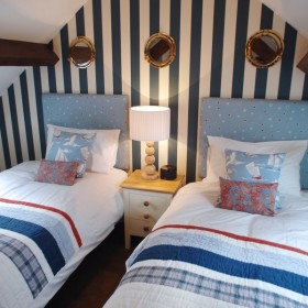 Cosy loft bedroom nautical style designed by Fabric Gallery & Interiors - photo